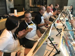 Improve communication skills through painting - conversation during team building event